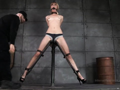 Lovely blonde beauty is wailing wildly from her atrocious bondage punishment