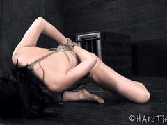 Hogtied babe with a rope on her neck is coughing from master's rough fingering