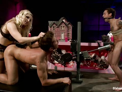 Two handsome slaves have to compete with each other to earn mistress pleasure