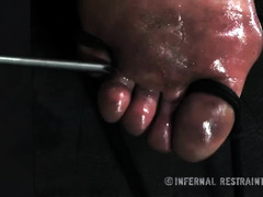Dungeon slave is restrained and suffers from her members' rough punishment