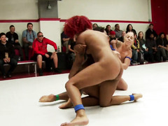 Curvaceous ebonies are getting their luscious pussies dominated in the arena