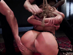 Busty blonde slave receives rough flogging while riding on stud's cock zealously