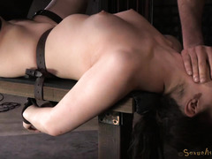 Lovely brunette is struggling with master's rough cock gagging and sybian riding