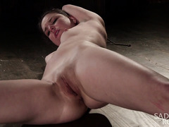 Sweet brunette is moaning and crying from master's merciless and kinky punishment