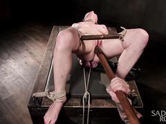 Cute tattooed brunette experiences rough flogging during kinky bondage punishment