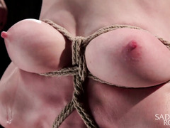 Cute tattooed brunette experiences rough flogging during kinky bondage punishment