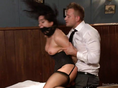 Lusty stud gets to fuck busty dark-haired babe after her husband lost his bet