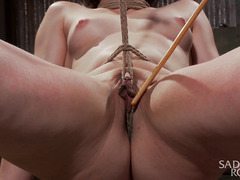 Ruthless caning and painful flogging for beautiful curvaceous redhead beauty