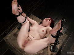 Alluring redhead experiences orgasmic delights from master's harsh punishment