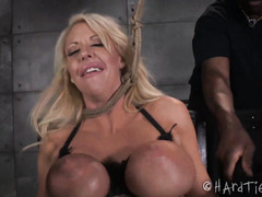 Busty blonde barbie receives rough cropping and whipping from tough black master