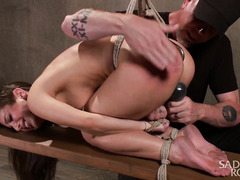 Brunette receives rough flogging for her hot natural tits while being suspended