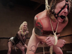 Tough tattooed stud surrenders totally to the lusty demands of hot blonde mistress