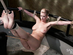 Suspended and gagged blonde enjoys wicked fingering and pleasuring for her twat