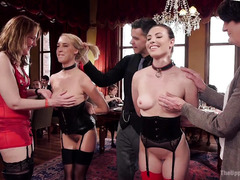 Lovely blonde and brunette slaves are punished for not serving the house properly