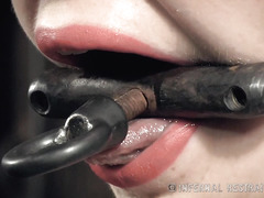 Dark-haired beauty in sexy high heels drools excessively from gagged torture