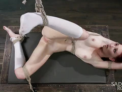 Redhead gets her pussy punished while being bounded and suspended in the air