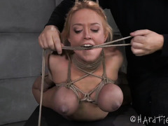 Captivating blonde gets her massive tits tied up tightly during rough punishment